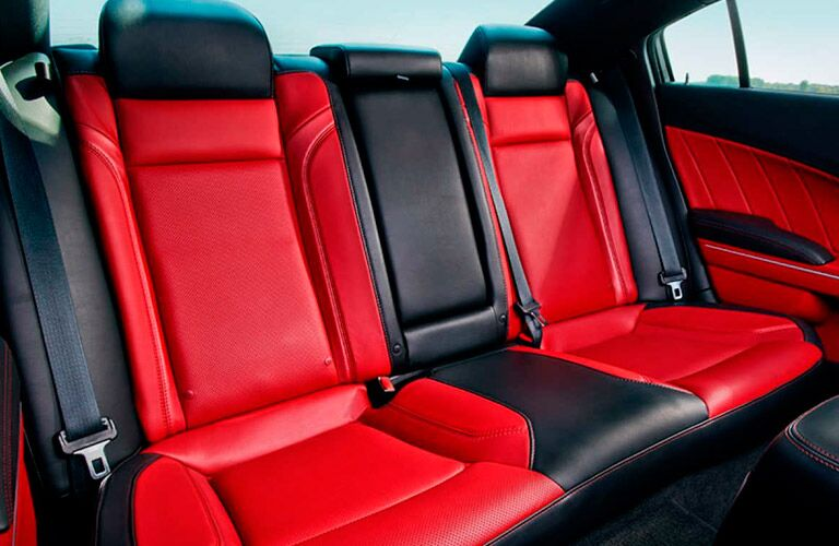 2017 Dodge Charger with two tone red and black seats
