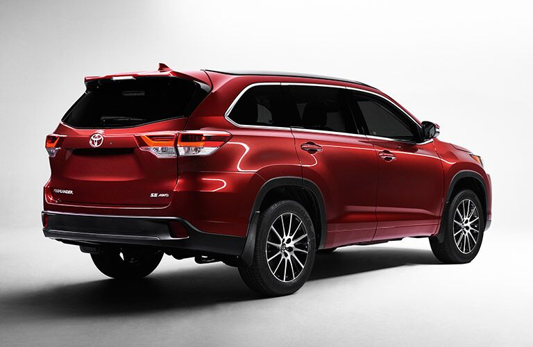Rear/side profile of red 2017 Toyota Highlander
