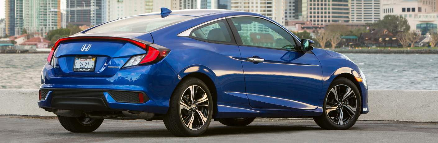 Passenger side exterior view of a blue 2018 Honda Civic Coupe