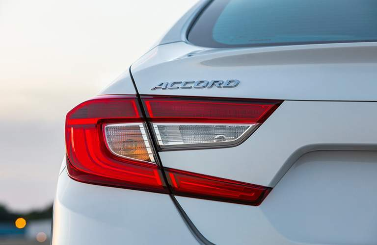 "Rear drivers side taillight and ""Accord"" badge of the 2018 Honda Accord"