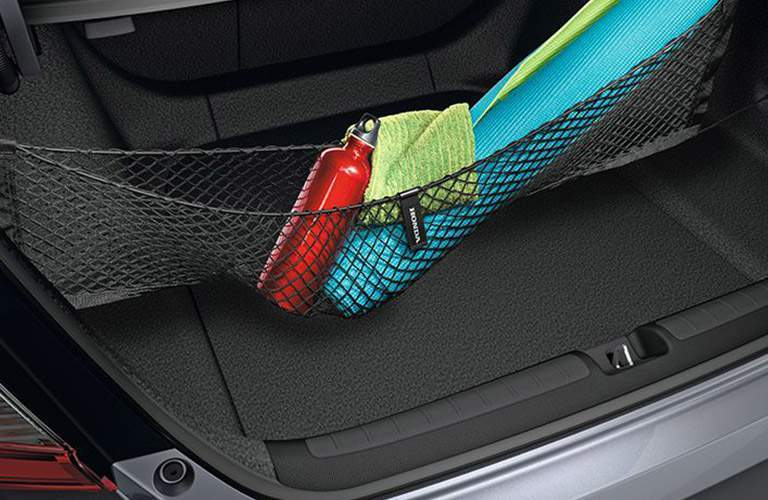 2018 Honda Accord's trunk space with available cargo net full of yoga equipment