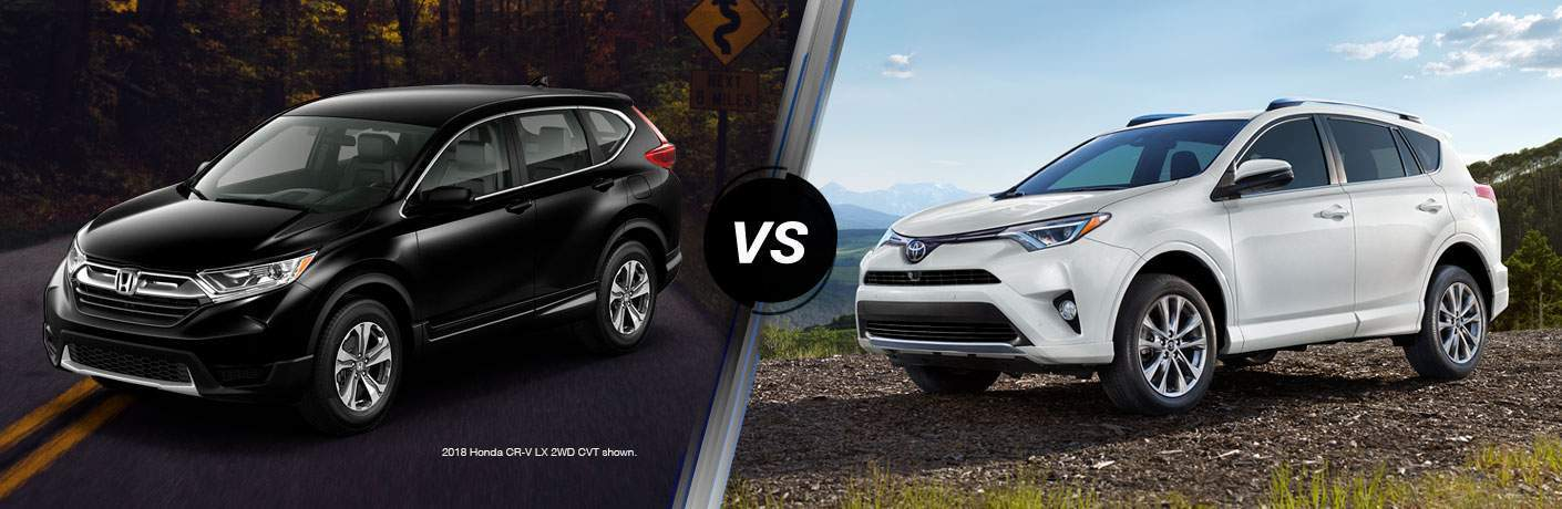 "Driver side exterior view of a black 2018 Honda CR-V on the left ""vs"" Driver side exterior view of a white 2018 Toyota Rav4 on the right"