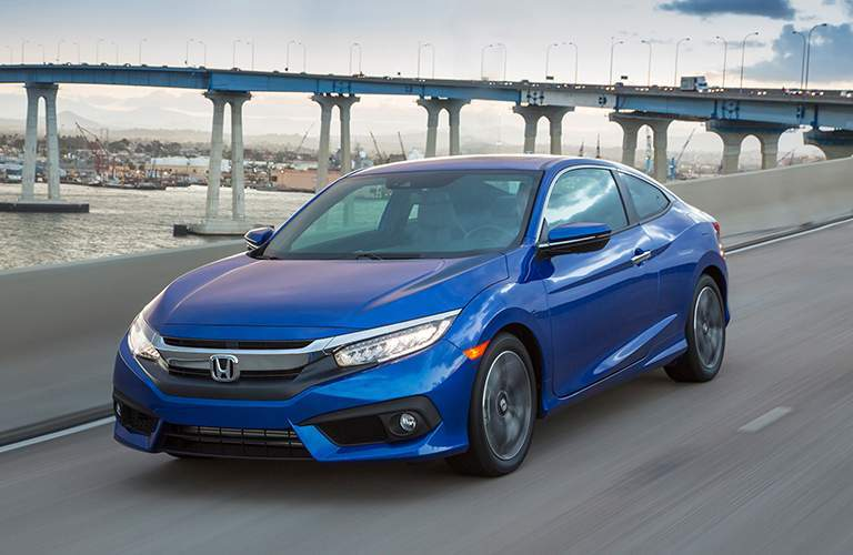front driver side exterior view of a blue 2018 Honda Civic Coupe
