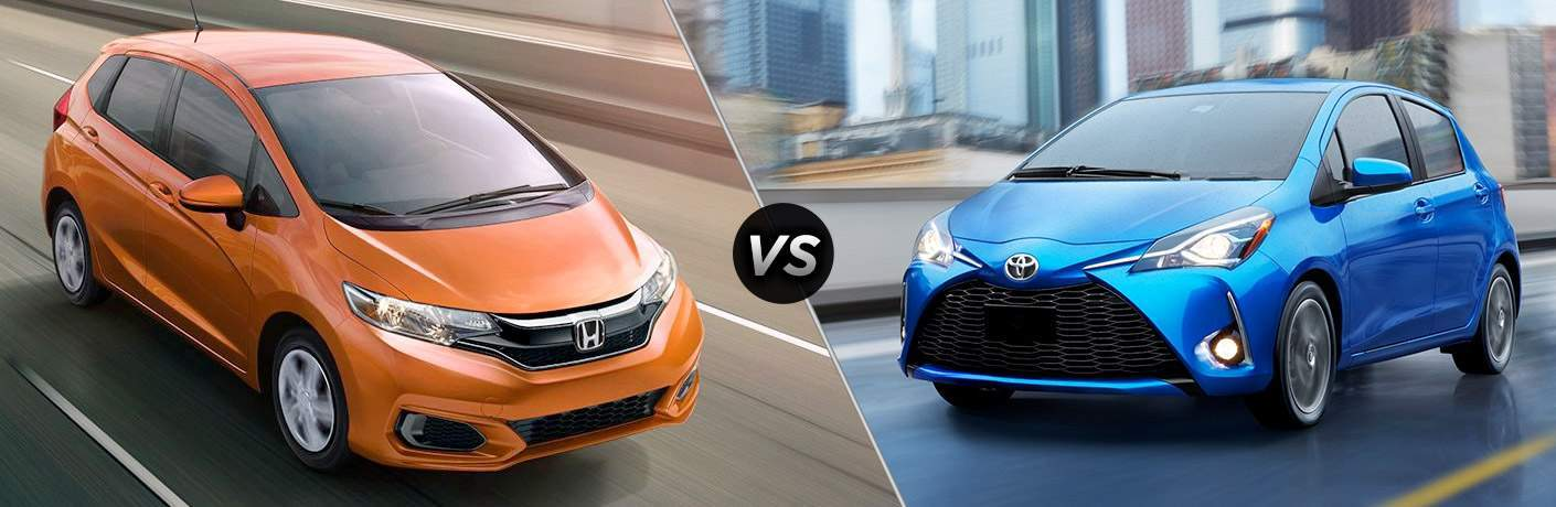 "Front exterior view of an orange 2018 Honda Fit on the left ""vs"" front exterior view of a blue 2018 Toyota Yaris on the right"