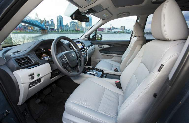2018 Honda Pilot interior front cabin side view of seats steering and dashboard