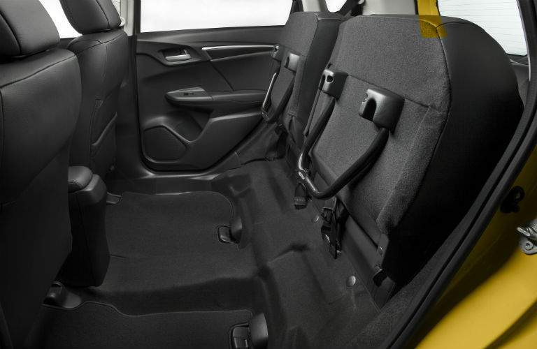 Rear seat of the 2018 Honda Fit folded up for storage