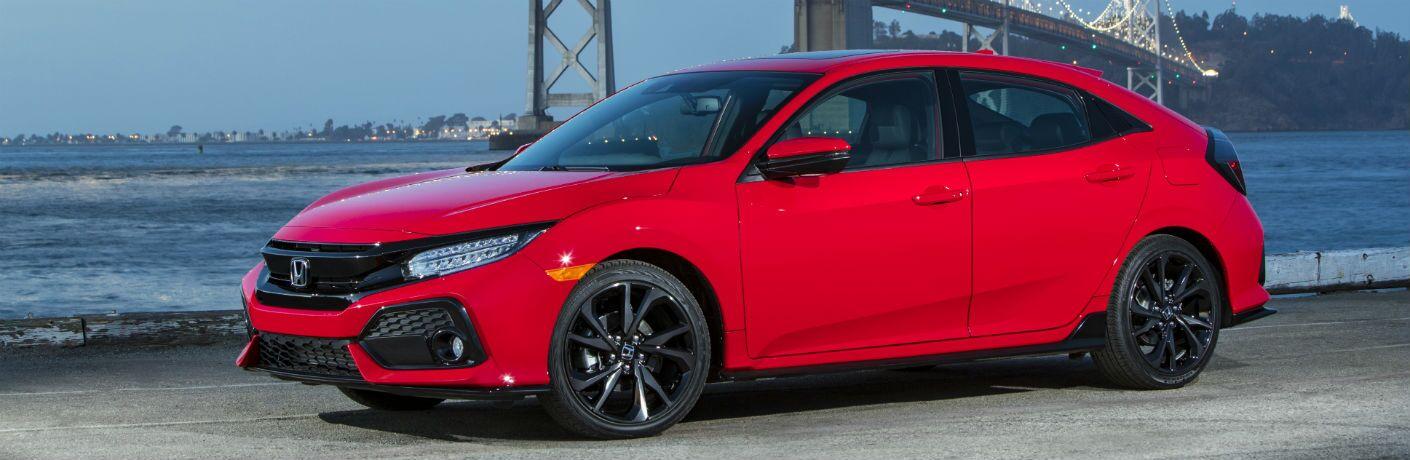 side exterior of a red 2019 Honda Civic Hatchback