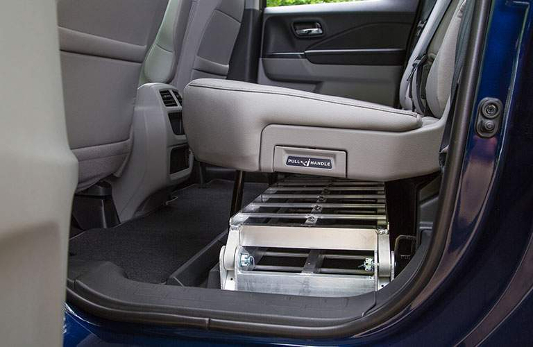 Side view of the rear seats of the 2018 Honda Ridgeline with a ladder stowed underneath