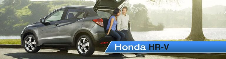 Happy couple sitting on the tailgate of the Honda HR-V