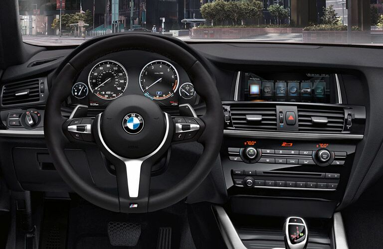2017 BMW X4 steering wheel and dashboard view