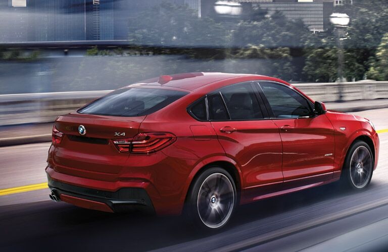 sleek red 2017 BMW X4 on the road
