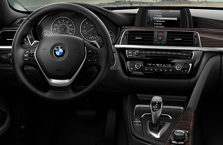 close view of the steering wheel and infotainment system of the 2018 BMW 4 Series