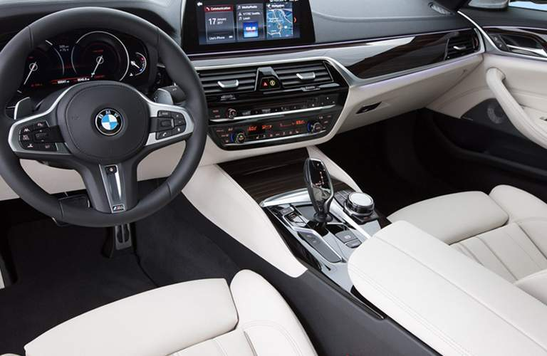 steering wheel and front seats of the 2018 BMW 5 Series