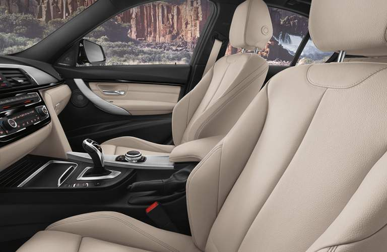 luxurious front seats of the 2018 BMW 3 Series in white or tan