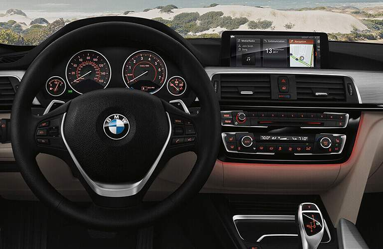 steering wheel, gauge cluster and infotainment in the 2018 BMW 3 Series