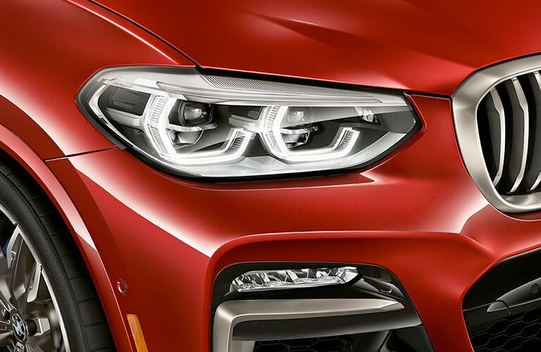 right headlight of red bmw x4