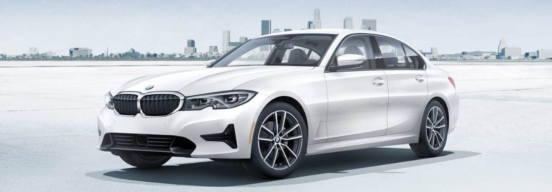 2020 BMW 3 Series 330i with cityscape background