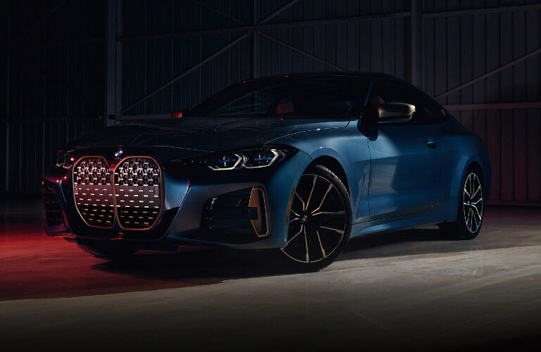 2021 BMW 4 Series Coupe in dark warehouse