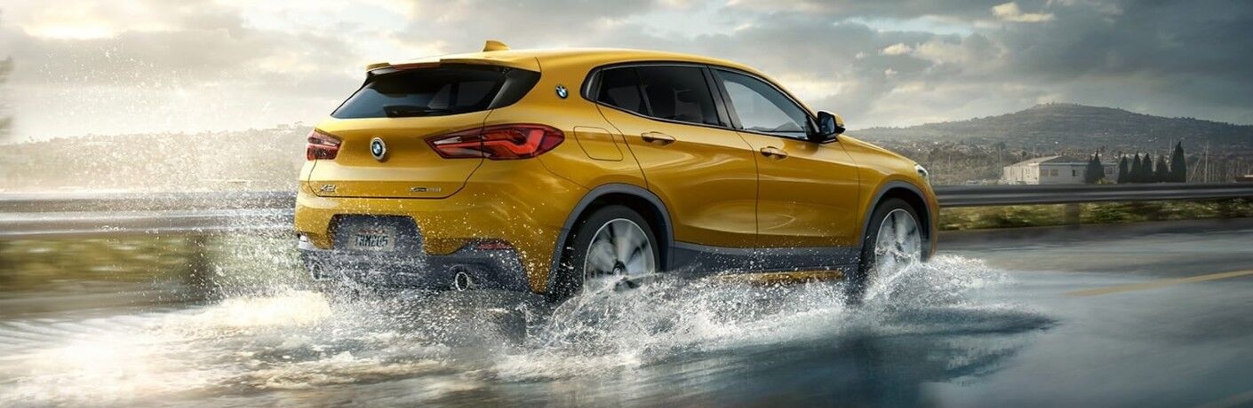 2021 BMW X2 driving over flooded pavement