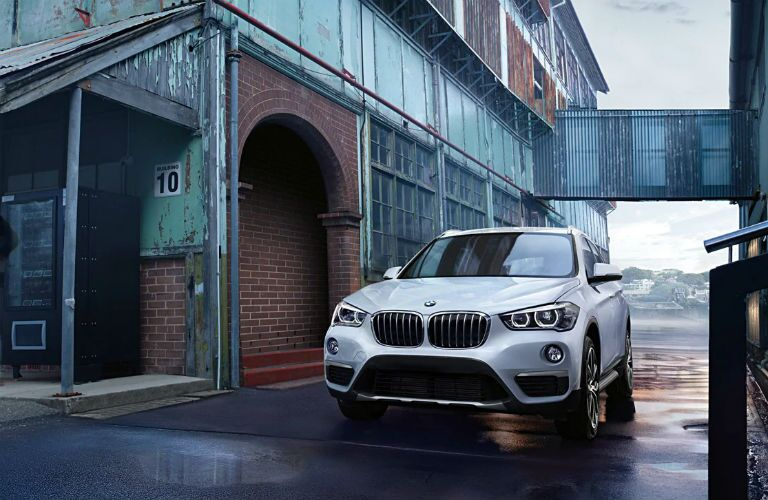 2019 bmw x1 parked in front of a warehouse