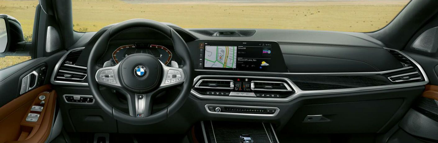 2019 BMW X7 Technology Features shown in closeup of dashboard and steering wheel