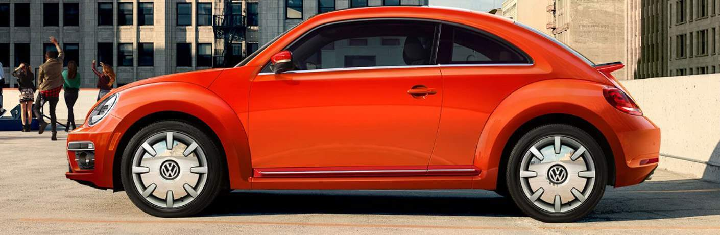 side view of an orange 2018 Volkswagen Beetle