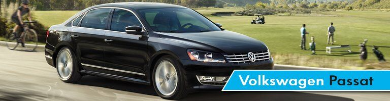 "2017 VW Passat driving through the countryside, labeled ""Volkswagen Passat"""