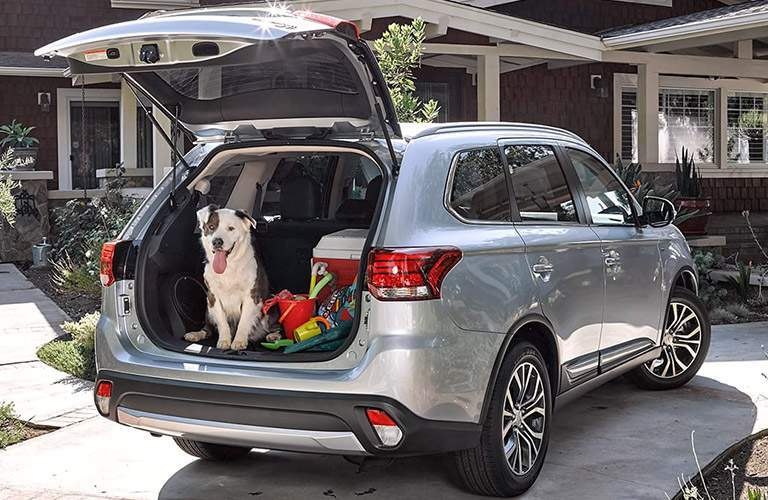 2017 Mitsubishi Outlander exterior liftgate open and packed with a dog inside