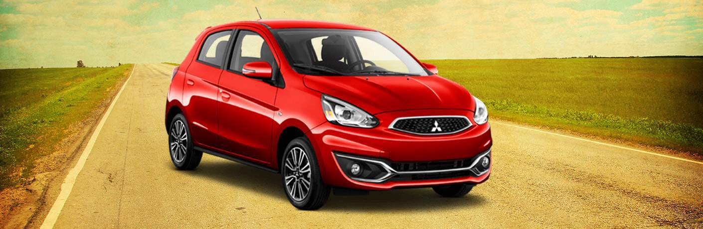 2018 Mitsubishi Mirage in red parked on a country road