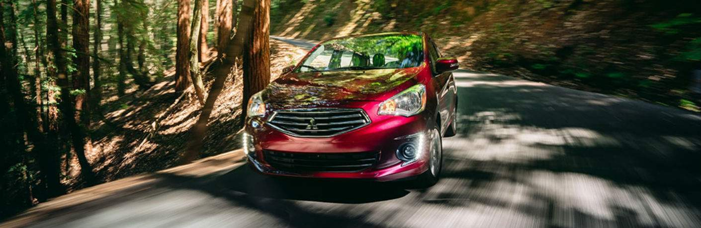 2018 Mitsubishi Mirage G4 driving down a curvy road in a forest