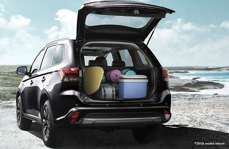 2019 Mitsubishi Outlander PHEV with back open showing cargo space
