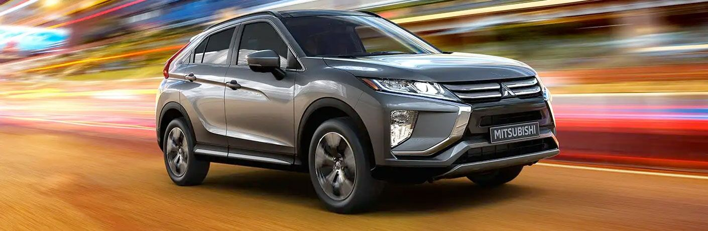 2020 Mitsubishi Eclipse Cross transcends time and space as it drives through a multicolored void.