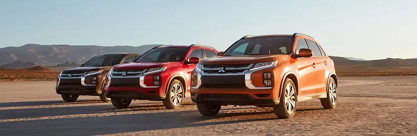 Three 2020 Mitsubishi Outlander Sport models lined up out in the desert.