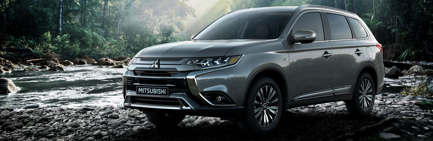 Silver 2020 Mitsubishi Outlander parked in nature