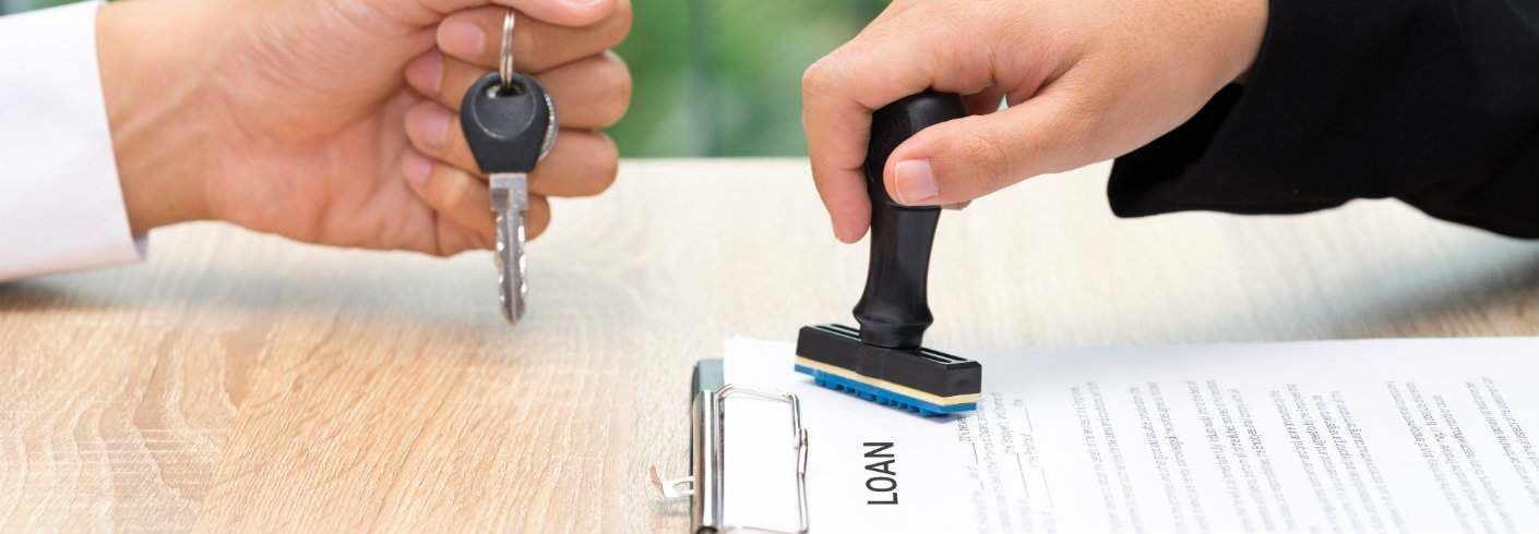 loan being approved and car keys handed to new owner