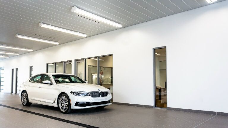 BMW indoor vehicle service lane at the New BMW and Volkswagen of Topeka