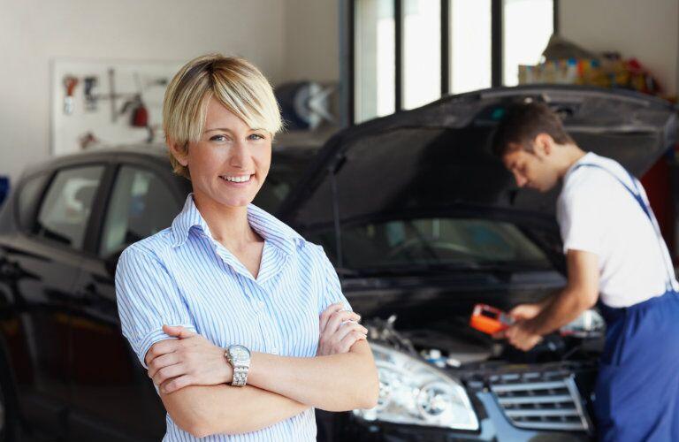 happy woman getting car repairs