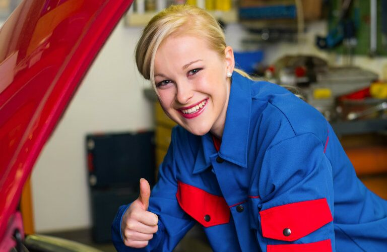 happy female service technician giving the thumbs up