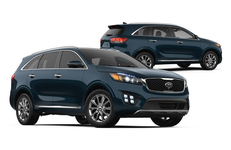 Two 2016 Kia Sorentos over a white background