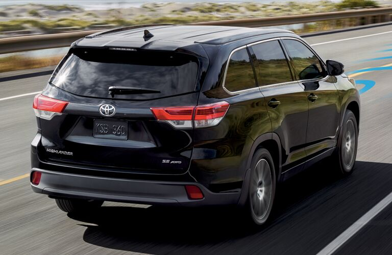 Rear view of black 2018 Toyota Highlander with driver assistance features highlighted