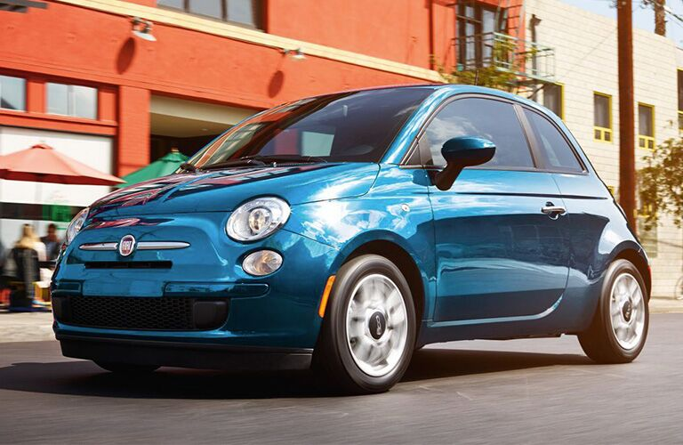 blue 2018 Fiat 500 driving