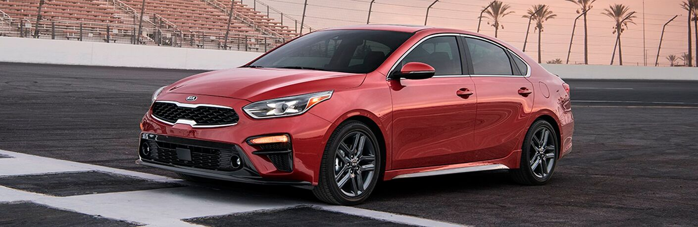 2019 Kia Forte exterior shot with red paint job parked at the start/finish line at a race track