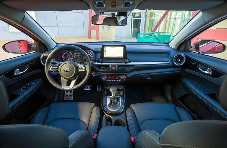 2019 Kia Forte interior shot of front seating, steering wheel, and dashboard organization