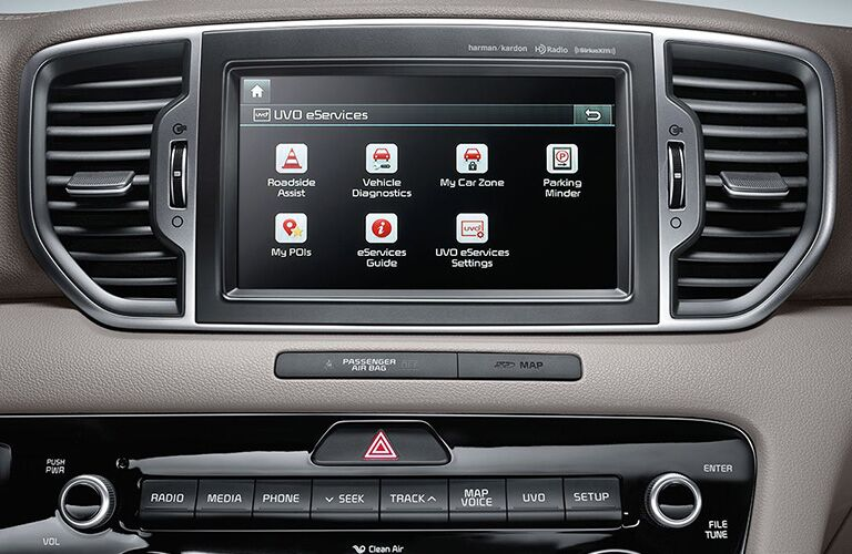 2019 Kia Sportage interior closeup shot of UVO infotainment screen with feature applications menu