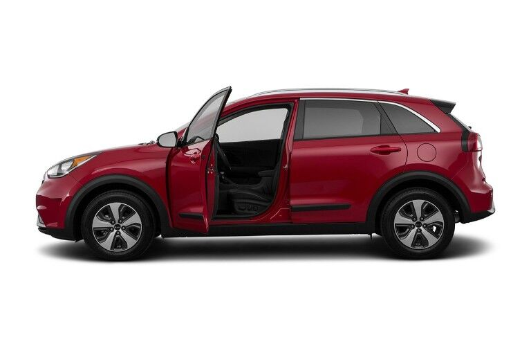 2019 Kia Niro exterior side shot with red paint color and front driver's door open