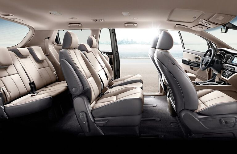 2021 Kia Sedona minivan interior side shot of 3-row seating upholstery and cabin space