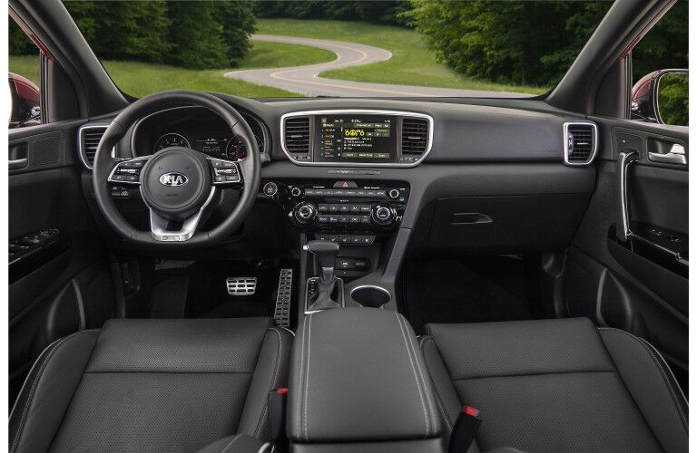 2020 Kia Sportage redesign interior shot of front seating, steering wheel, and dashboard layout design