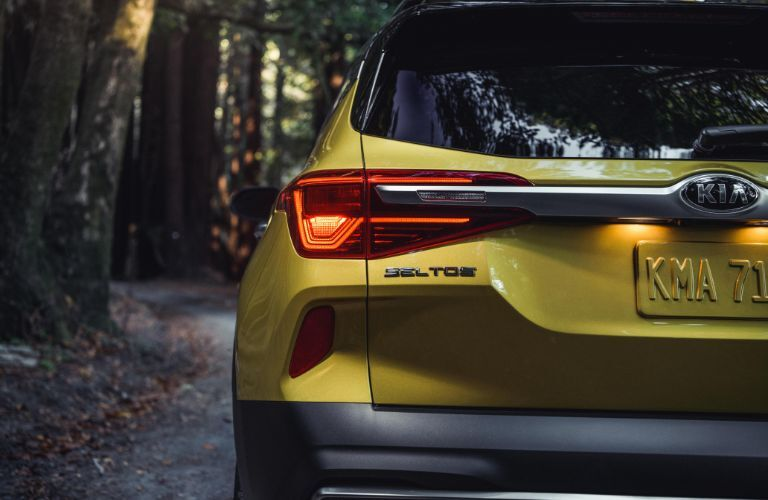 2021 Kia Seltos exterior rear shot of bumper, trunk, and taillights with Starbright Yellow paint color
