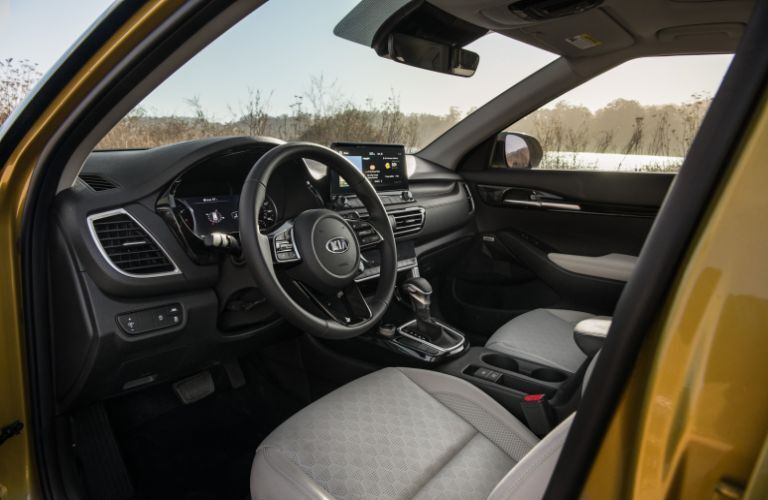 2021 Kia Seltos interior shot of front seating, steering wheel, and dashboard