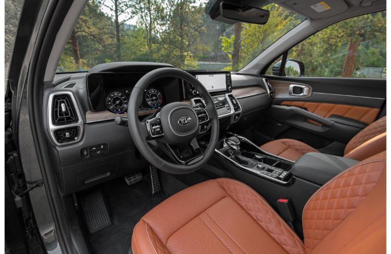 2021 Kia Sorento interior shot of front seating, steering wheel, and dashboard layout
